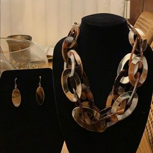 Brown and cream necklace and earrings set.
